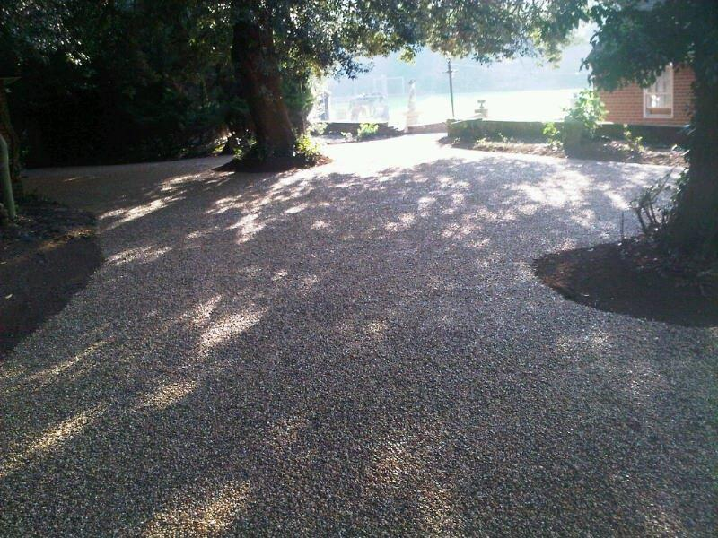 Resin bonded driveway laid around trees